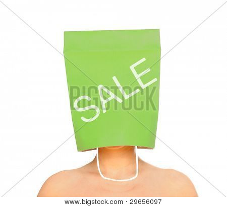 A portrait of a young woman with her head covered with a green shopping bag
