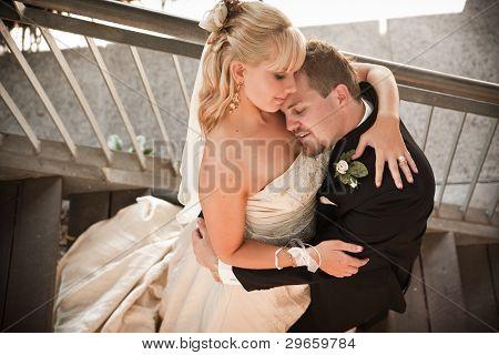 Groom Resting Head Against The Bride