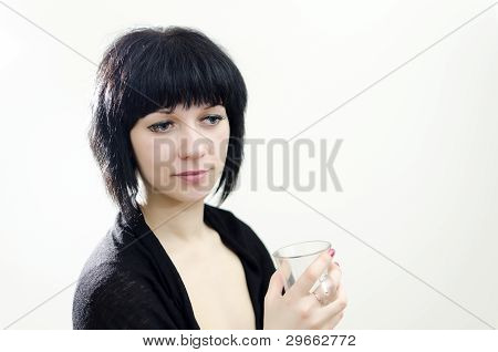 Portrait Of Brunette Girl With Glass.