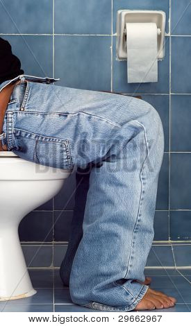 Man Sit In Blue Bathroom