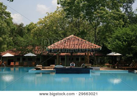 Swimming Pool and Traditional Style Hut at a Luxury Hotel