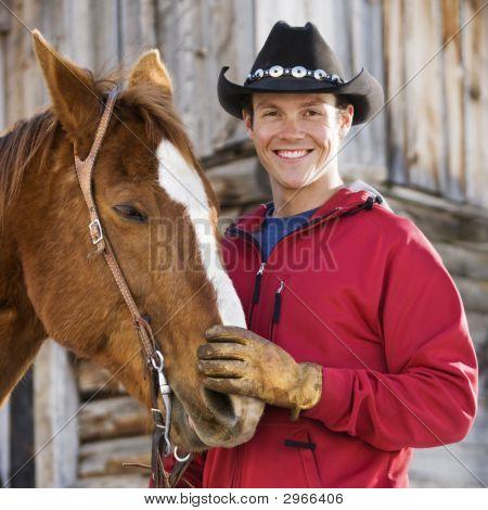 Man Petting Horse.