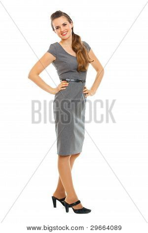 Full Length Portrait Of Smiling Woman In Dress