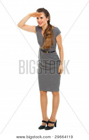 Full Length Portrait Of Business Woman Looking Into Distance