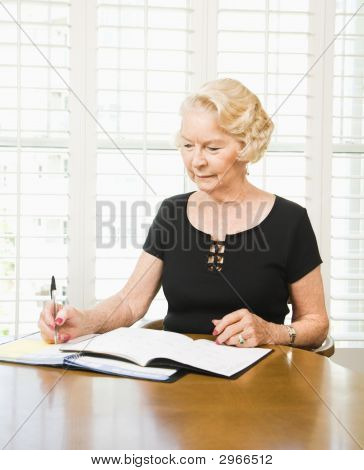 Mature Woman With Calendar.