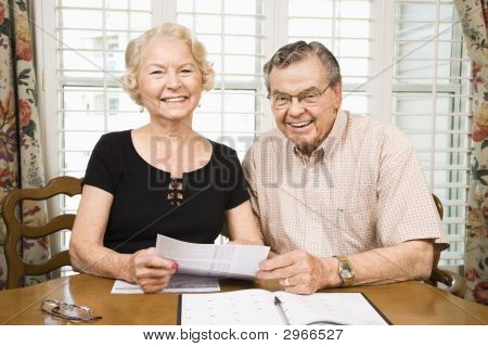Mature Couple With Bills.