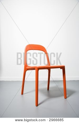An Orange Modern Chair.