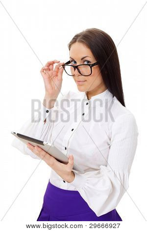 Strict beautiful girl wearing glasses, white blouse and purple skirt standing and holding tablet PC