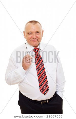 Smiling senior business man wearing white shirt and tie holding glasses over cutout background