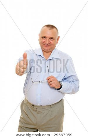Smiling senior business man showing thumb up sign and holding glasses over cutout background