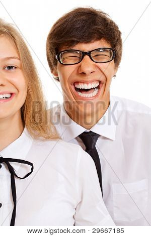 Laughing young man and half face of smiling pretty girl in white shirts and black ties over white isolated background