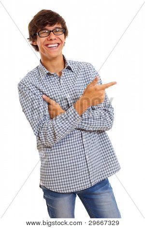 Smiling young man with glasses wearing blue jeans and checkered shirt shows forefinger on something. Isolated on white background, mask included
