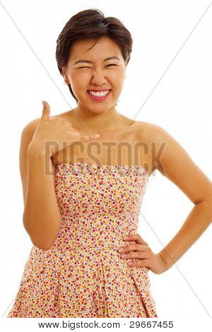 Beautiful young woman in sundress standing, winking and showing phone symbol isolated on white background. Mask included