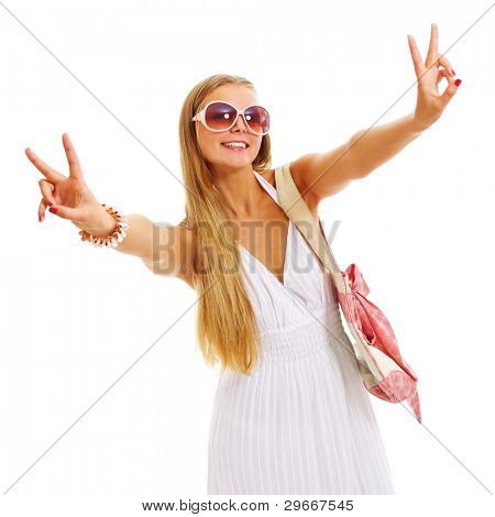 Beautiful blonde young woman in sundress and sunglasses on holiday standing and showing victory symbol isolated on white background. Mask included