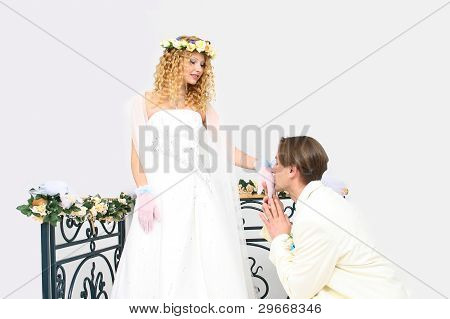 Young Couple Posing In A Studio On The Wedding Day Stock photo