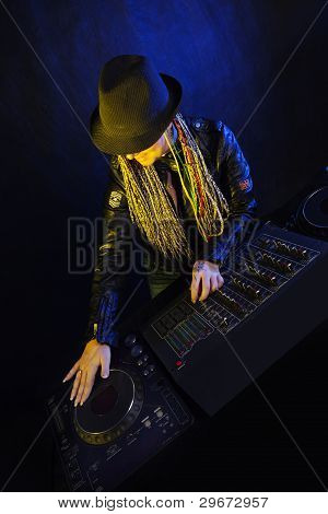 Dj Woman Playing Music by mixer