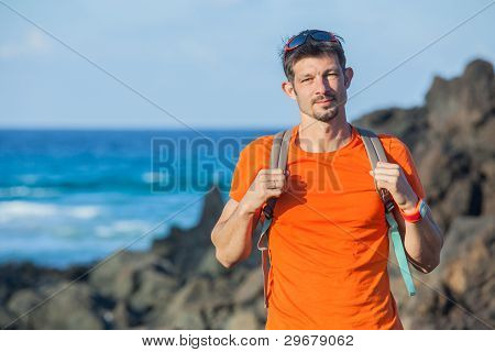portrait young man with backpack