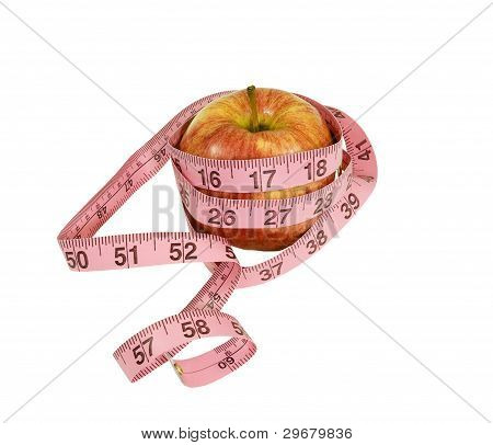 fresh apple with measuring tape around