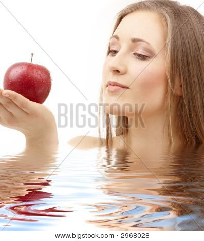 Woman With Red Apple In Water