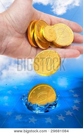 Euro coins falling to the water. European financial crisis metaphor.