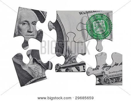Closeup of US Dollar banknote jigsaw pieces reflecting the state of economy