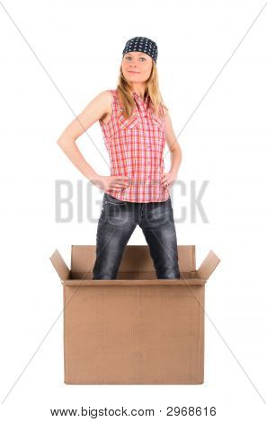 Proud Woman Standing In A Cardboard Box