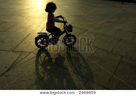 Kid Riding Bicycle Silhouette