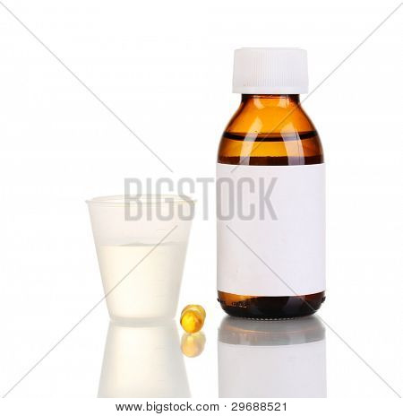 Medical bottle with jigger and tablets isolated on white