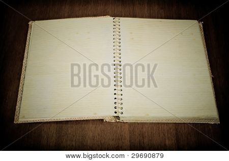 Blank old photo album on the wooden table