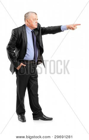 Full length portrait of an angry boss firing an employee isolated on white background