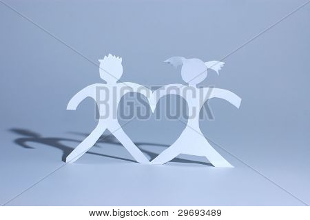 Paper Girl And Boy Holding On Hands And Forming Heart Between Figures