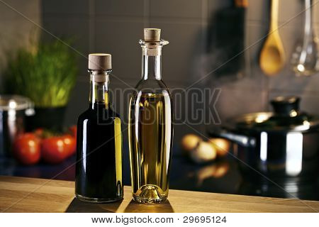 Oil And Vingar Bottles In Front Of A Kitchen