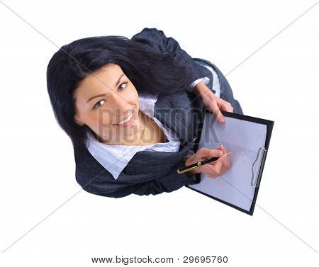 Top view of smiling business woman writing in clipboard