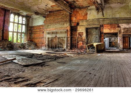 Hardwood floors, fireplace, window, and chair. Abandoned church.