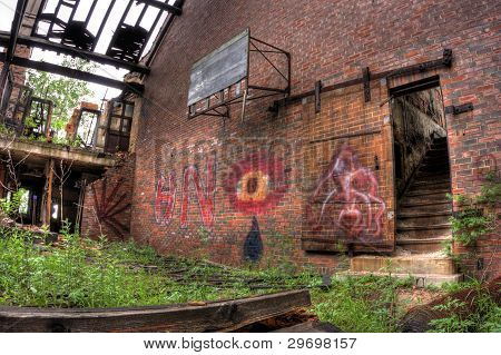 Gymnasium being reclaimed by nature. City Methodist Church.