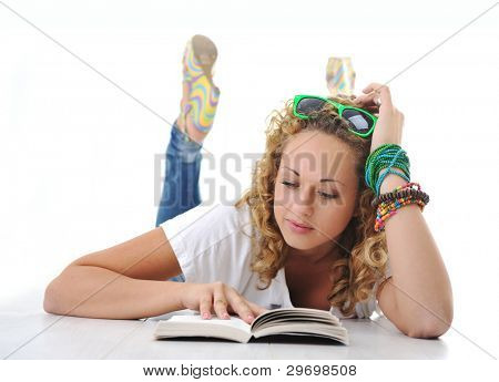 Female teenager laying and reading book