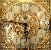 stock photo of tick tock  - Elegant grandfather clock face golden color time - JPG