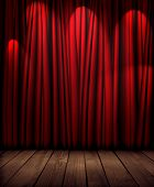 stock photo of cinema auditorium  - red theater curtain with soft lighting - JPG