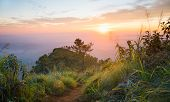 Gold Sunset And Purple Light Phu Nom At Phu Langka National Park Thailand With Fog On Sky Wide. Phu  poster
