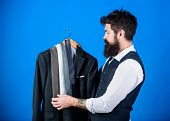 Man Bearded Hipster Hold Neckties And Formal Suit. Guy Choosing Necktie. Perfect Necktie. Shopping C poster