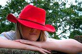 Girl With Red Stetson Style Hat