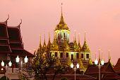 View Of The Top Of The Old Chedi Loha Prasat In Lilac Twilight. Bangkok, Thailand poster