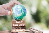 Save World Or Earth Day Concept. Hands Holding Model Globe Clay With Radar On Wooden Block Tower For poster