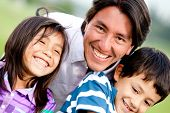 stock photo of tickle  - Single parent family portrait looking very happy and smiling - JPG
