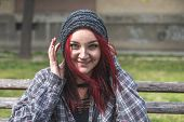 Smiling Homeless, Positive Smiling Homeless Red Hair Girl Sitting On The Bench On The Street And Loo poster