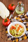 Ready-to-eat Salad Of Tomatoes And Peking Cabbage In A Plate, Vegetables And A Bottle Of Oil On A Wo poster