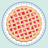 picture of cherry pie  - Traditional American homemade cherry pie with a lattice pastry dough top on a decorated plate.