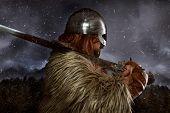 Viking scandinavian warrior with sword and wild skins. leather and bib overalls, metal helmet poster
