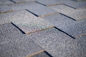 Close Up View On Asphalt Roofing Shingles Background. Roof Shingles - Roofing. poster