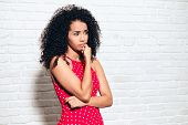 Worried Young African American Woman Biting Nails For Sadness Anxiety poster